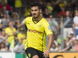 Dortmund's Ilkay Gundogan kicks the ball during the first round of the DFB Cup match between SV Wilhelmshaven and Borussia Dortmund at Jade Stadium in Wilhelmshaven, Germany on August 3, 2013