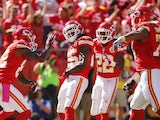 Jamaal Charles of the Kansas City Chiefs celebrates with his team after scoring the first touchdown for the Kansas City Chiefs against the Oakland Raiders on October 13, 2013