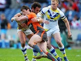 Jason Netherton of Hull KR is stopped by Jon Clarke of Warrington during the Super League Magic Weekend match between Warrington Wolves and Hull KR at Murrayfield Stadium on May 3, 2009
