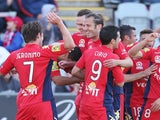 Jeronimo Neumann of Adelaide United celebrates a goal with teamates during the round one A-League match against Perth Glory on October 13, 2013