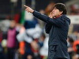 German head coach Joachim Low reacts during the FIFA 2014 World Cup Group C qualifying football match Germany vs Republic of Ireland in Cologne, western Germany on October 11, 2013