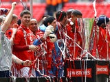 Luke Murphy of Crewe Alexandra and team mates celebrate with the trophy during the Johnstone's Paint Trophy Final match between Crewe Alexandra and Southend United at Wembley Stadium on April 7, 2013