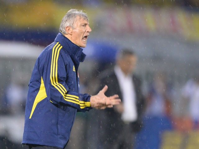 Colombia's coach, Argentine Jose Pekerman, gives instructions to the players during their Brazil 2014 FIFA World Cup South American qualifier match against Ecuador, in Barranquilla, Colombia, on September 6, 2013