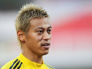 Japan national team player Keisuke Honda looks on during training ahead of their international friendly match against Serbia at stadium Karadjordje on October 10, 2013