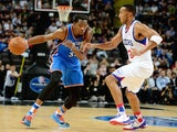 Oklahoma City Thunder forward Kevin Durant drives with the basketball during a pre-season match against the Philadelphia 76ers in Manchester on October 8, 2013
