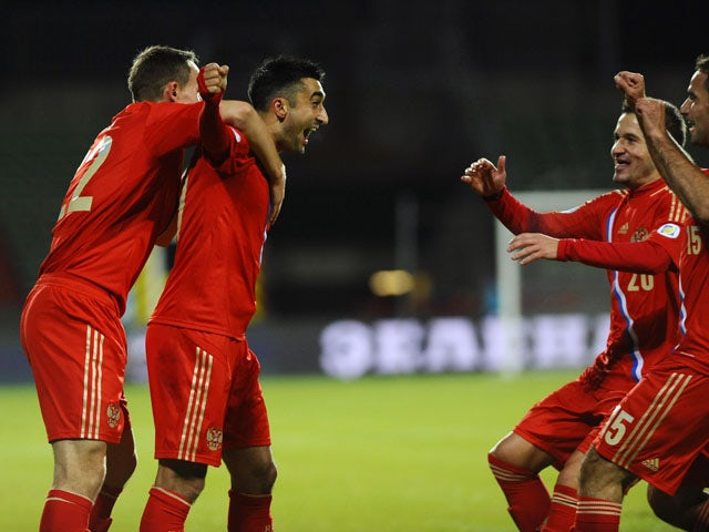 Russia's Alexander Samedov celebrates with teammates after scoring during the FIFA 2014 World Cup Group F qualifying match between Luxembourg and Russia on October 11, 2013
