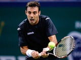 Marcel Granollers of Spain returns a shot to Janko Tipsarevic of Serbia during day one of the Shanghai Rolex Masters at the Qi Zhong Tennis Center on October 7, 2013