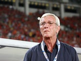 Manager Marcello Lippi of Guangzhou Evergrande looks on during the AFC Champions League Semi Final Second Round match between Guangzhou Evergrande and Kashiwa Reysol at the Tianhe Stadium on October 2, 2013