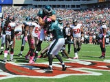 Quarterback Nick Foles of the Philadelphia Eagles celebrates after a touchdown run in the 1st quarter against the Tampa Bay Buccaneers October 13, 2013