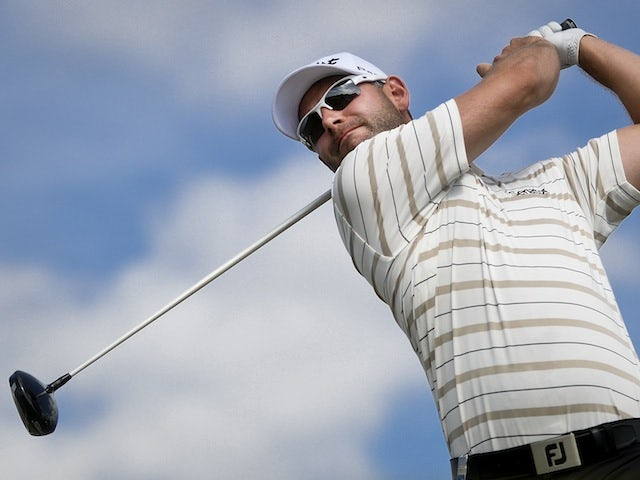 Paul Waring tees off during the third round of the Portugal Masters at Victoria Golf Course in Vilamoura on October 12, 2013
