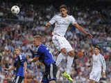 Raphael Varane of Real Madrid CF heads the ball beside Ragnar Sigurdsson of FC Copenhagen during the UEFA Champions League match between Real Madrid CF and FC Copenhagen at Estadio Santiago Bernabeu on October 2, 2013