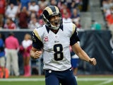 Sam Bradford of the St. Louis Rams celebrates a second quarter touchdown pass against the Houston Texans at Reliant Stadium on October 13, 2013