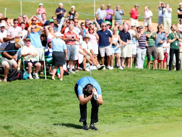 Scott Jamieson of Scotland reacts after narrowly missing a chip shot for birdie and a 59 on the 18th hole during the third round of the Portugal Masters on October 12, 2013