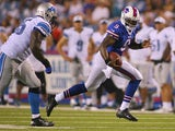 Thad Lewis #9 of the Buffalo Bills runs against the Detroit Lions at Ralph Wilson Stadium on August 29, 2013