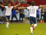 Graham Zusi #19 of the U.S. Men's National Soccer Team celebrates after scoring the first goal of the game against Jamaica midway in the second half at Sporting Park on October 11, 2013