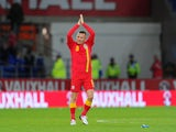 Wales player Craig Bellamy applauds the crowd after his last home appearance after the FIFA 2014 World Cup Qualifier Group D match between Wales and Macedonia at Cardiff City Stadium on October 11, 2013