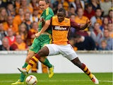 Zaine Francis-Angol of Motherwell tangles with Aleksei Koslov of Kuban Krasnodar during the UEFA Europa League Third Round Qualifying First Leg match between Motherwell and Kuban Krasnodar at Fir Park Stadium on August 01, 2013