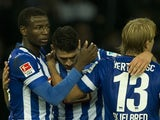 Hertha's Adrian Ramos, Tolga Cigerci, and Per-Ciljan Skjelbred celebrate after the German first division Bundesliga football match Hertha Berlin vs Moenchengladbach on October 19, 2013