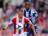 Andy Wilkinson of Stoke City and Saido Berahino of West Brom battle for the ball during the Barclays Premier League match between Stoke City and West Brom on October 19, 2013