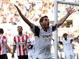 Angel Rangel of Swansea City celebrates his goal during the Barclays Premier League match between Swansea City and Sunderland at Liberty Stadium on October 19, 2013