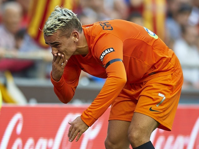 Antoine Griezmann of Real Sociedad celebrates after scoring the first goal during the La Liga match between Valencia CF and Real Sociedad at Estadio Mestalla on October 19, 2013
