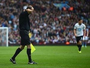 Flare hits linesman at Villa Park