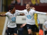 Roberto Soldado of Spurs celebrates scoring their second goal with Paulinho of Spurs during the Barclays Premier League match between Aston Villa and Tottenham Hotspur at Villa Park on October 20, 2013