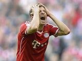 Bayern Munich's striker Thomas Muller reacts during the German first division Bundesliga football match between FC Bayern Munich and FSV Mainz 05 on October 19, 2013