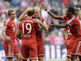 Bayern players celebrate the second goal for Munich during the German first division Bundesliga football match between FC Bayern Munich and FSV Mainz 05 on October 19, 2013