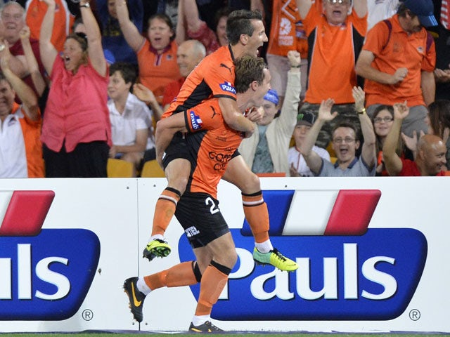 Matthew Smith and Liam Miller of the Roar celebrate a goal during the round two A-League match between Brisbane Roar and Sydney FC at Suncorp Stadium on October 19, 2013