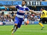 Charlie Austin Of Queens Park Rangers celebrates scoring to make it 2-1 during the Sky Bet Championship match between Millwall and Queens Park Rangers at The Den on October 19, 2013