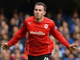 Cardiff City's English midfielder Jordon Mutch celebrates after scoring during the English Premier League football match between Chelsea and Cardiff City at Stamford Bridge in London, on October 19, 2013