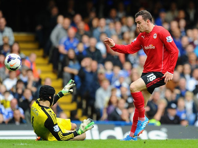 Jordon Mutch of Cardiff beats Petr Cech to score the first goal during the Barclays Premier League match between Chelsea and Cardiff City at Stamford Bridge on October 19, 2013