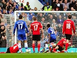 Chelsea's Cameroonian forward Samuel Eto'o scores his team's second goal during the English Premier League football match between Chelsea and Cardiff City at Stamford Bridge in west London on October 19, 2013