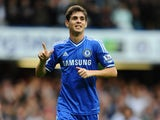 Oscar of Chelsea celebrates scoring his side's third goal during the Barclays Premier League match between Chelsea and Cardiff City at Stamford Bridge on October 19, 2013