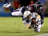 Running back Danny Woodhead #39 of the San Diego Chargers is tackled by free safety Danieal Manning #38 of the Houston Texans in the second quarter at Qualcomm Stadium on September 9, 2013