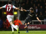 David Silva of Manchester City scores his team's third goal during the Barclays Premier League match between West Ham United and Manchester City on October 19, 2013