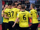 Dortmund's midfielder Nuri Sahin and his teammates celebrate during the German first division Bundesliga football match Borussia Dortmund vs Hannover 96 in the German city of Dortmund on October 19, 2013