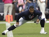 Duane Brown #76 of the Houston Texans stretches before playing the St. Louis Rams at Reliant Stadium on October 13, 2013