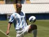 Malaga's new player Argentinian midfielder Fernando Damian Tissone does keepie-up during his official presentation at the Rosaleda stadium in Malaga on July 6, 2013