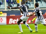 Juventus' French midfielder Paul Labile Pogba celebrates with teammate Carlo Tevez after scoring during the Italian Serie A football match Fiorentina vs Juventus on October 20, 2013