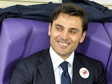 Fiorentina's coach Vincenzo Montella smiles before the Italian Serie A football match Fiorentina vs Juventus on October 20, 2013