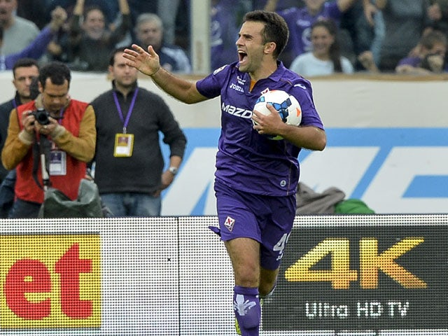 Fiorentina's midfielder Giuseppe Rossi celebrates after scoring during the Italian Serie A football match Fiorentina vs Juventus on October 20, 2013