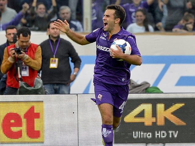 Fiorentina's midfielder Giuseppe Rossi celebrates after scoring during the Italian Serie A football match Fiorentina vs Juventus on October 20, 2013