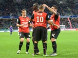 Rennes' Algerian midfielder Foued Kadir is congratulated by teammates after scoring during the French L1 football match Rennes against Valenciennes on October 19, 2013