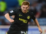 Wigan's Fraser Fyvie in action against Huddersfield Town on February 17, 2013