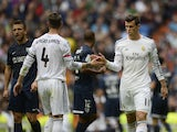 Real Madrid's Welsh striker Gareth Bale greets Real Madrid's defender Sergio Ramos during the Spanish league football match Real Madrid vs Malaga on October 19, 2013