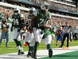 Quarterback Geno Smith of the New York Jets celebrates after he ran for a touchdown in the 3rd quarter of the New York Jets 30-27 win over the New England Patriots on October 20, 2013