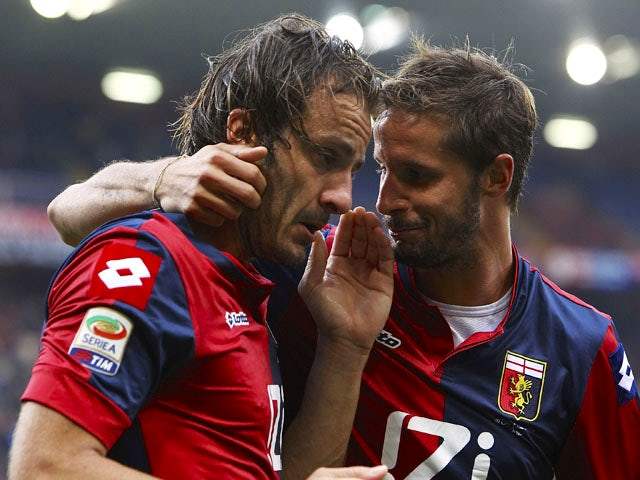 Alberto Gilardino of Genoa CFC celebrates after scoring his second goal with team-mate Luca Antonini (R) during the Serie A match between Genoa CFC and AC Chievo Verona at Stadio Luigi Ferraris on October 20, 2013