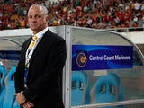 Team Coach Graham Arnold of Central Coast Mariners looks on during the AFC Champions League knockout round match between Guangzhou Evergrande and Central Coast Mariners at Tianhe Stadium on May 22, 2013